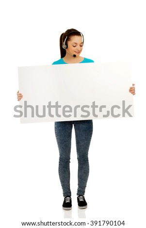 Call center woman with billboard. - stock photo
