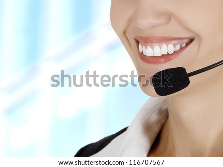 Call center woman with headset against abstract background