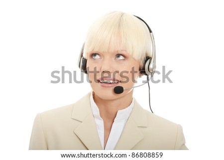 Call center woman with headset looking up right corner. Isolated on white background.