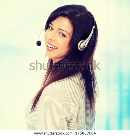 Call center woman with headset. Over abstract blue background  - stock photo