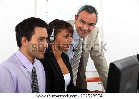 Call-center worker being trained - stock photo