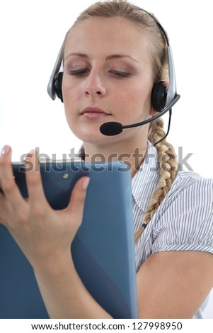 Call centre agent writing on a clipboard - stock photo