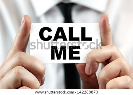 Call me. Businessman in white shirt with a black tie, shows business card. - stock photo