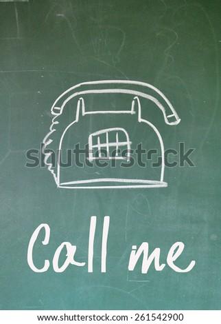 call me sign on blackboard - stock photo