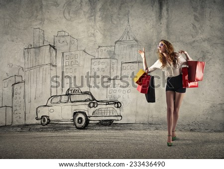 Calling a taxi after shopping  - stock photo