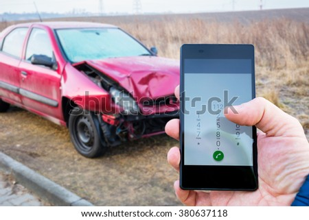 Calling for help after car crashed - stock photo