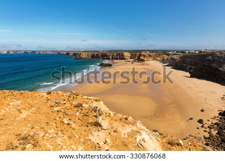 Calm and clear seaside with little rocky hills, Portugal - stock photo