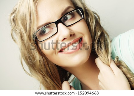 calm and friendly blond woman with glasses - stock photo