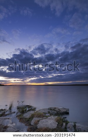 Calm and tranquil Senset over a reservoir - stock photo