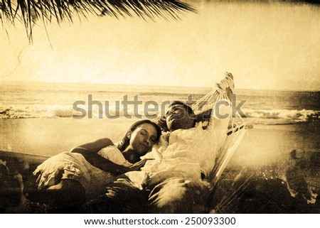 Calm couple napping in a hammock against grey background - stock photo