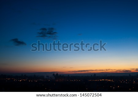 Calm evening cloudscape in city with almost clear sky - stock photo