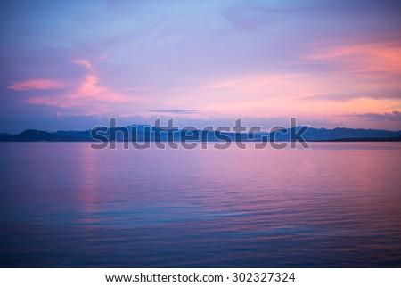 calm evening sunset scene at the water at Golfo Aranci, Sardinia, Italy - stock photo