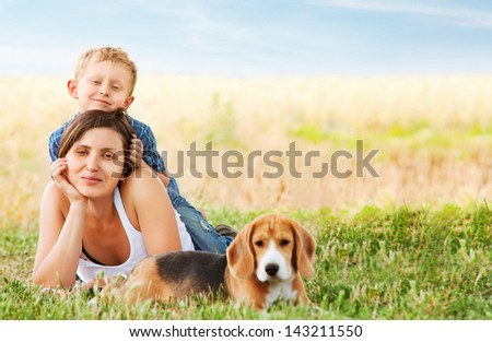 Calm family leisure scene on the green meadow - stock photo