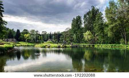 Calm lake lanscape in belgium countryside, spring time - stock photo