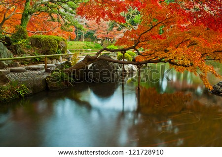 Calm , natural and quiet Japanese style park and garden with long exposure , koishikawa korakuen , tokyo , japan - stock photo