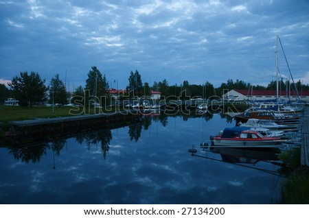 Calm night view of a yacht harbor in Oulu, Finland