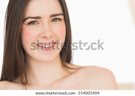 Calm nude brunette looking at camera on white background - stock photo