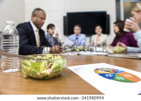 Calm people in business formal outfit eating - stock photo
