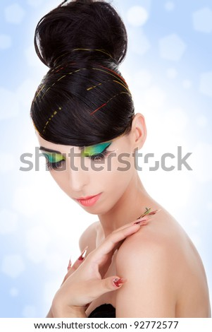 calm portrait of a luxury woman model with beautiful makeup and fancy long fingernails - stock photo