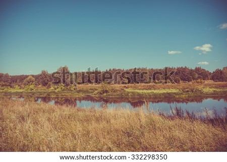 Calm river and green forest, nice peaceful landscape, vintage effect.