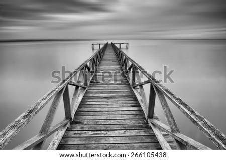 Calm scene in black and white with abandoned jetty at Penang seaside - stock photo
