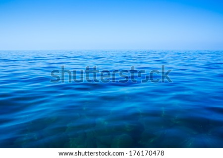 Calm sea and blue clear sky in summer day - stock photo
