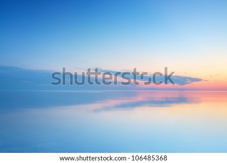 Calm sea and sky during sundown. Bright seascape background - stock photo