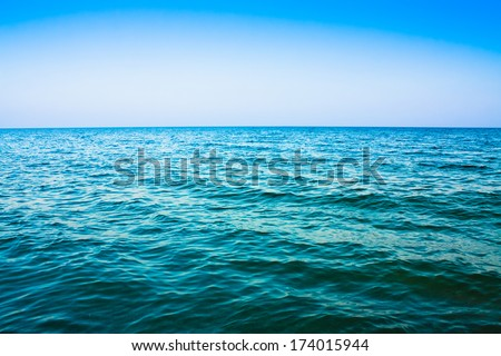 Calm sea ocean and blue clear sky background texture view
