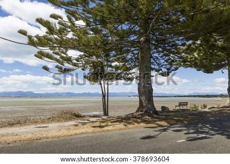 Calm seas of the Abel Tasman National Park, South Island, New Zealand - stock photo