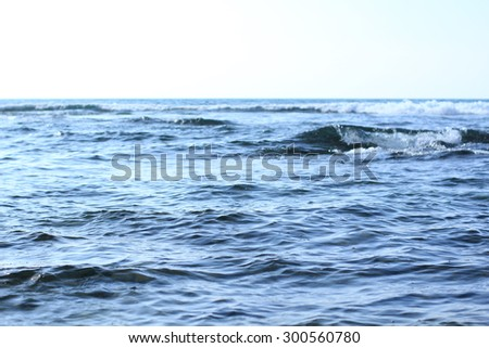 Calm, Serene, Tranquil, Shallow & Rippled Blue Waters In Motion Against Bright Sunny Sky Off The Coastline Of Kona, Hawaii In The Summertime - stock photo