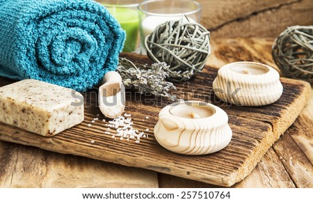 Calm Spa Scene, Wellness Setting with Towel,Natural Soap ,Candles and Lavender Bouquet on Wooden Table - stock photo