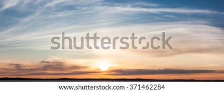 Calm sunset and clouds over lake - stock photo