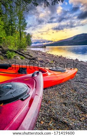 Calm sunset over Lake McDonald in Glacier National Park, MT - stock photo