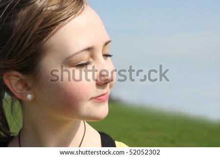 calm teen's face in the sun - stock photo