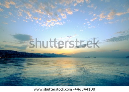 Calm water, blue sky and nice clouds