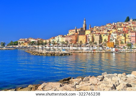Calm water of the Mediterranean sea near the old town of Menton, French Riviera, France