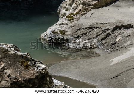 calm water with sand in a ravine