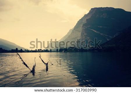 Calm waters of Toblino Lake. Trentino, Italy - stock photo