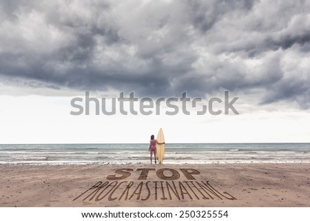 Calm woman in bikini with surfboard on beach against stop procastinating - stock photo