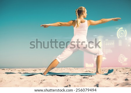 Calm woman standing in warrior pose on beach against fitness interface - stock photo
