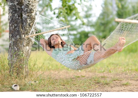calm young woman on hammock in the park