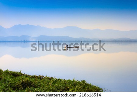 Calmness Lake in sunset - stock photo