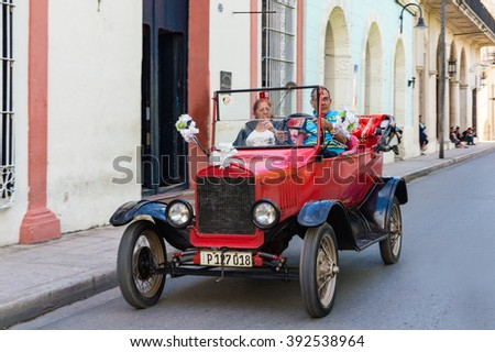 CAMAGUEY,CUBA-FEBRUARY 9,2016:Vintage red American convertible car, driven by tourist in Camaguey. 1910s vehicle are often used as wedding cars or tourist taxi.