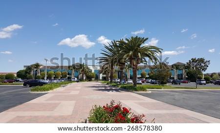 CAMARILLO, CA - APRIL 8, 2015: Private road leading to Hi-Tech company corporate headquarter office in Camarillo, California - stock photo