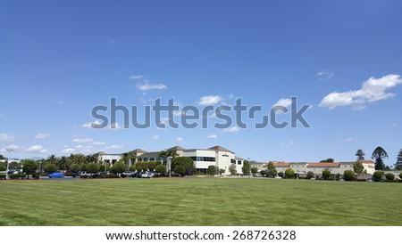 CAMARILLO, CA - APRIL 8, 2015: Semtech corporate headquarter office across perfectly manicured green grassy field in Camarillo, California - stock photo