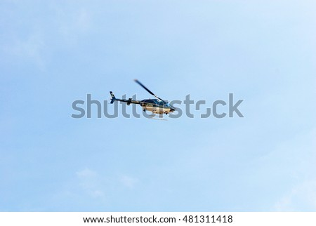 CAMARILLO/CALIFORNIA - AUG. 20, 2016: Sheriff Departments' Bell rotorcraft (helicopter) OH-58A flies over the Camarillo Airport. Camarillo, California USA