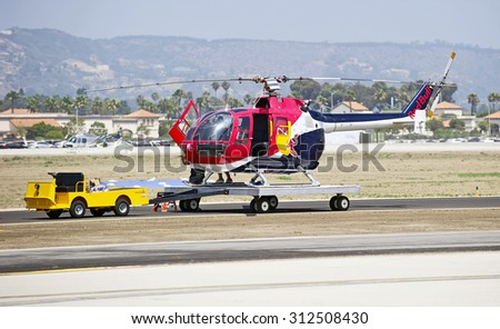 "CAMARILLO/CALIFORNIA - AUGUST 22, 2015: Messerschmitt-Bolkow-Blohm helicopter known as ""Red Bull"" approved by FAA for aerobatics at Wings over Camarillo Air Show in Camarillo, California USA"