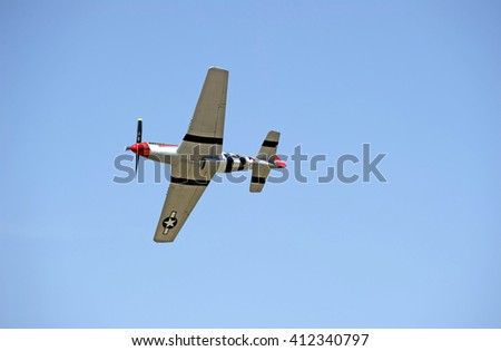 "CAMARILLO/CALIFORNIA - AUGUST 23, 2015: North American P-51 Mustang ""Man o' War"" single engine aircraft displaying its flying agility at the Wings Over Camarillo Airshow in Camarillo, California USA"