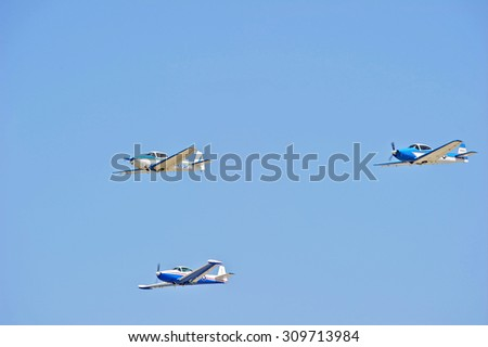CAMARILLO/CALIFORNIA - AUGUST 23, 2015: Vintage aircraft flying in formation demonstrate their flying agility at Wings Over Camarillo Airshow in Camarillo, California USA  - stock photo