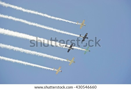 CAMARILLO/CALIFORNIA - AUGUST 22, 2015: Vintage military aircraft fly in formation displaying their flying agility at the Wings Over Camarillo Air Show in Camarillo, California USA